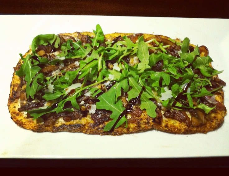 ... topped with goat cheese, caramelized red onions, mushrooms and arugula