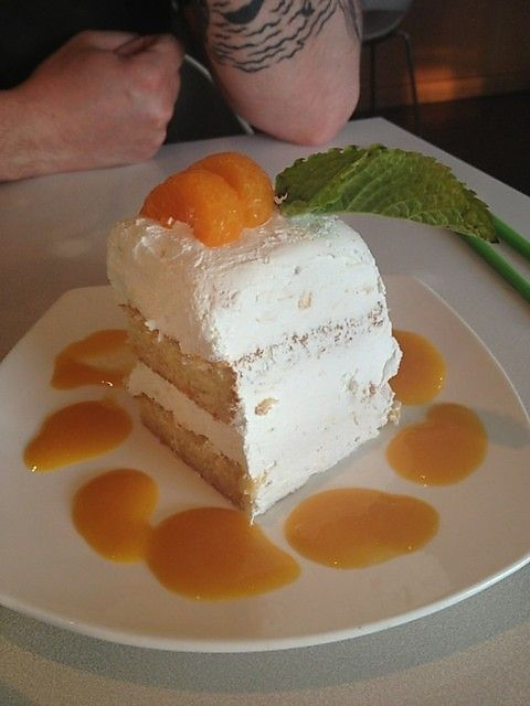 Mandarin Orange Cake with pineapple whipped cream icing