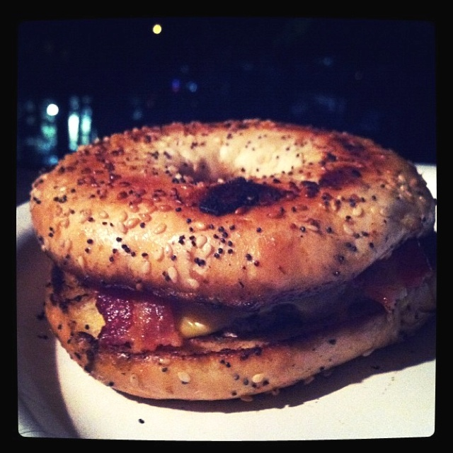 turkey burger with cheddar and bacon on a toasted everything bagel ...