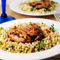 ... bed of Israeli couscous seasoned with lemon juice, chili and herbs