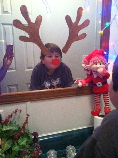 Jingle painted Rudolph antlers and a red nose on the mirror...now when ...