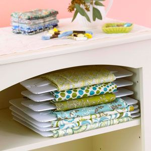 Fabric Organizers, available in small and large sizes, are fabric-safe boards suitable for holding a wrapped fabric piece. The boards have tabs that hold the initial end of the fabric piece in place as you wrap.