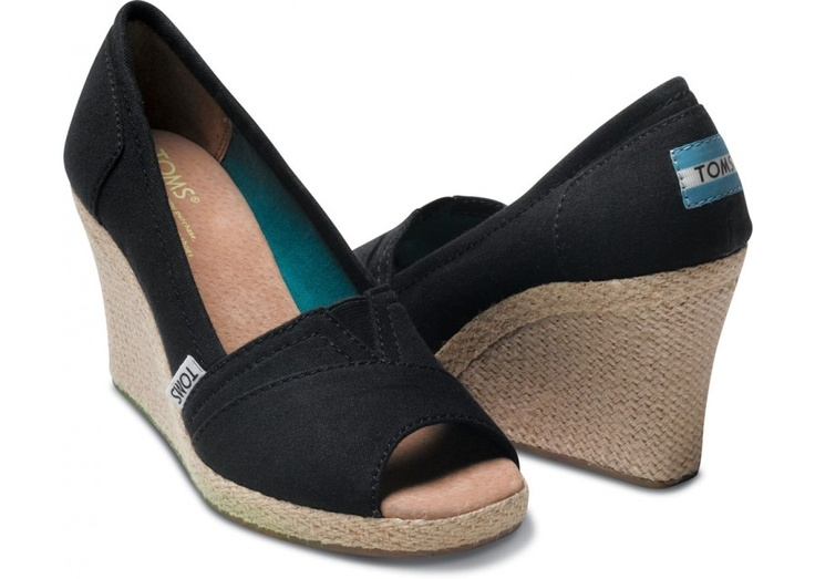 TOMS does it again with their black wedges.  The only pair of wedges with HEART.  Buy a pair and a pair goes to a child in need.  On my shopping list to buy next..  <3 these wedges.