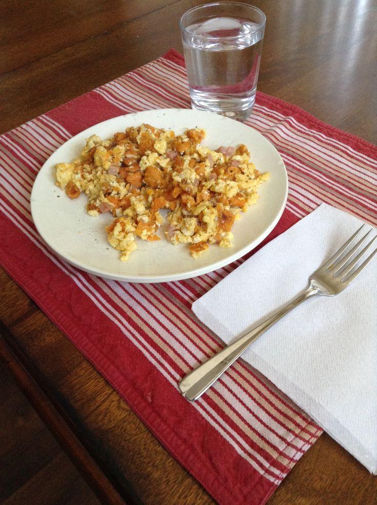 & cut up sweet potato fries until ham begins to pop. Scramble 2 eggs ...