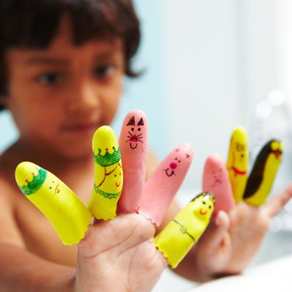 Sharpie + dishwashing gloves + scissors = bath time finger puppets.