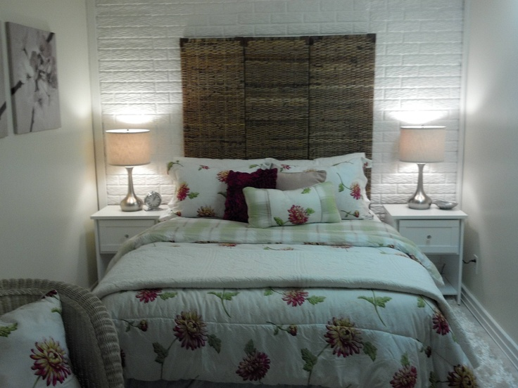 """Design on a nickel"" basement weightroom turned to bedroom. Headboardis old bamboo screen. Not a great pic.  / Gorgeous!!!"