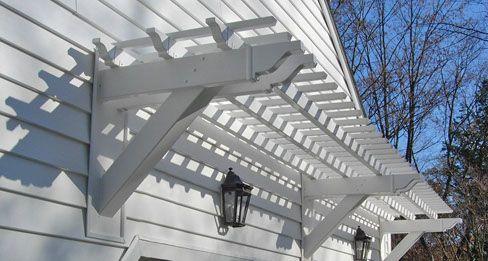 Vinyl wall pergola over garage doors | Backyard ideas ...