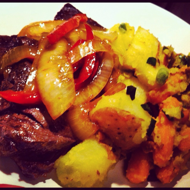 Skirt Steak smothered with Onions. Lemon Garlic Potatoes And Carrots.