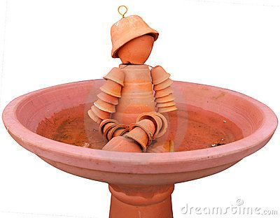 Flower pot man in a Bird Bath Isolated with clipping path