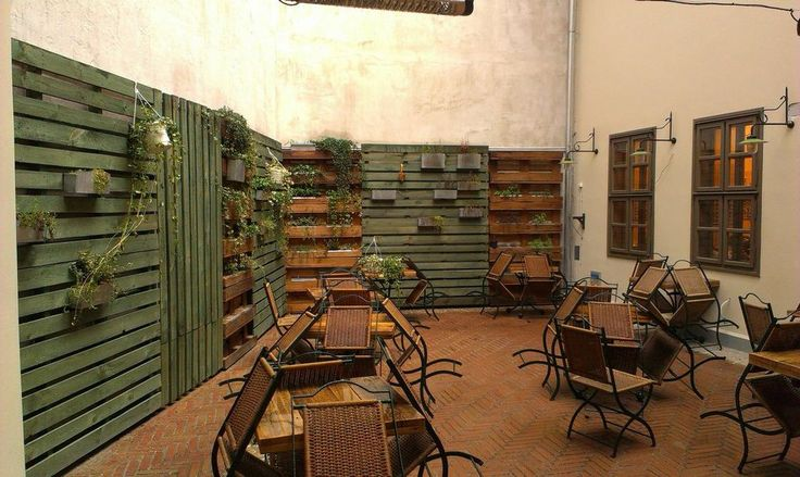 Pallet wall in a restaurant #PalletsWall, #Terrace
