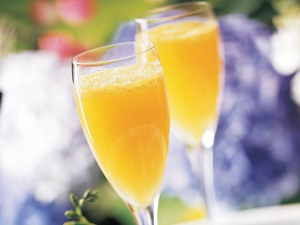 Peachy Mimosas 2 cups orange juice, chilled 2 cups peach nectar ...