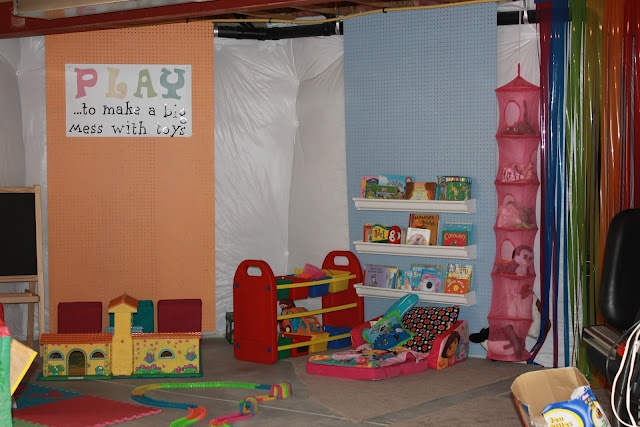 unfinished basement turned organized colorful playroom