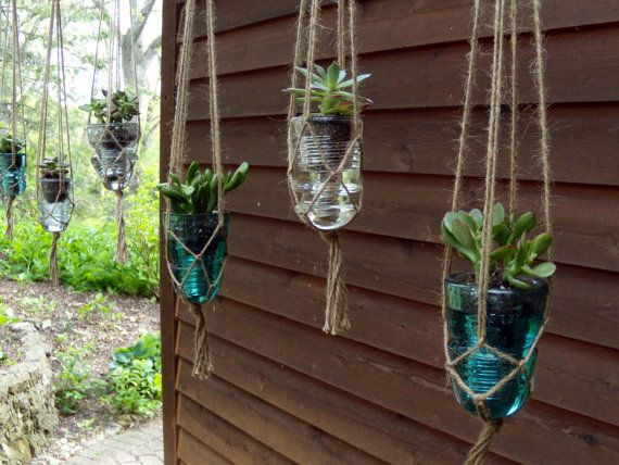Hanging succulent planter upcycled from vintage glass for Glass insulator ideas