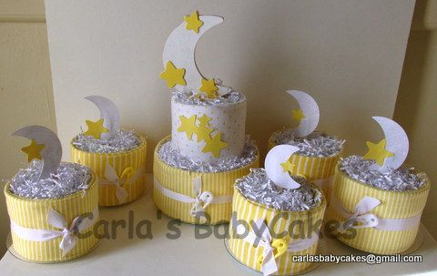 baby shower diaper cake an assortment of table decorations stars
