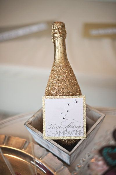 Cover your champagne bottles in glitter. | 51 DIY Ways To Throw The Best New Year's Party Ever