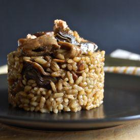 Paella with Iberian Pork ribs, wild mushrooms and foie. A burst of ...