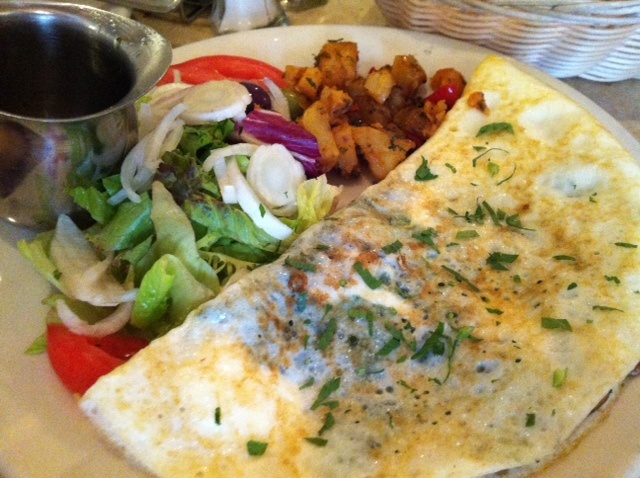 Egg white omelet with spinach, mushrooms, and goat cheese