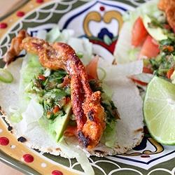 Crispy deep-fried chicken skin tacos with habanero salsa