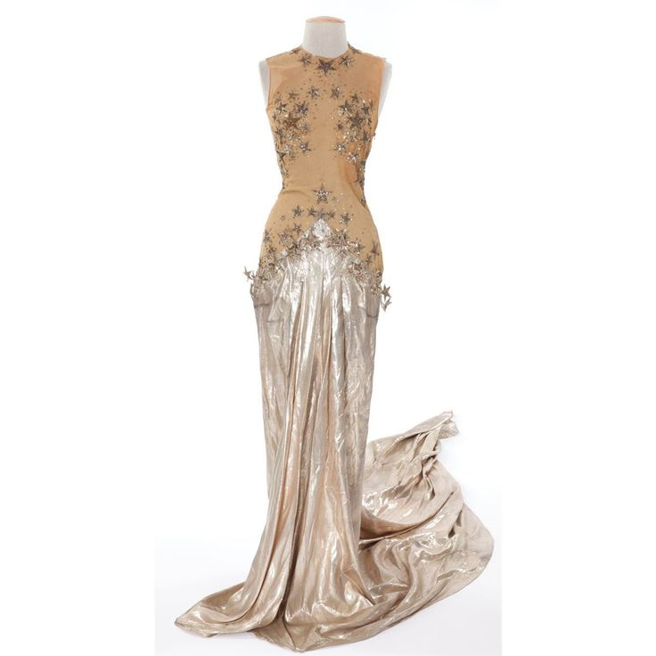 """(MGM, 1941) Elaborate costume of gold lamé skirt and nude netted bodice covered with silver sequined stars.  Designed by Adrian. Worn by Eve Arden as """"Patsy Dixon"""" during the You Stepped Out of a Dream number in Ziegfeld Girl."""