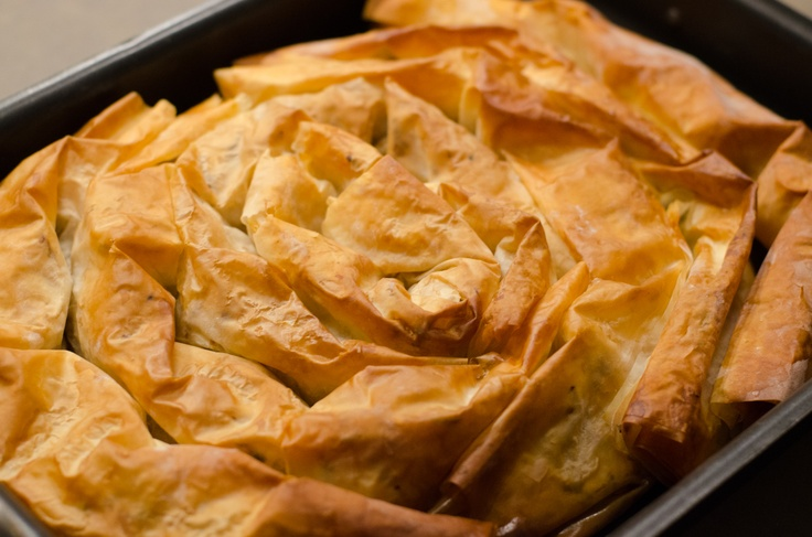 Banitza...like Baklava but better. Walnuts, butter, phyllo dough, yum ...