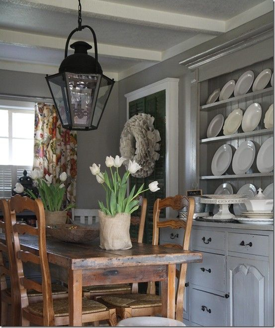 Rustic elegance. Love the plate rack and lantern.