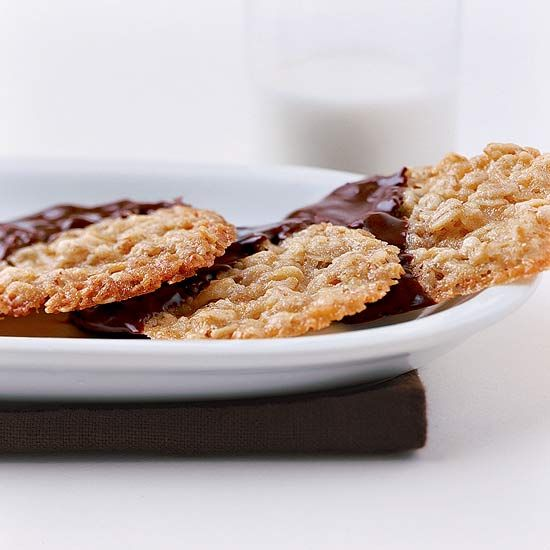 Dip these Buttery Oatmeal Crisps in chocolate after baking for a ...