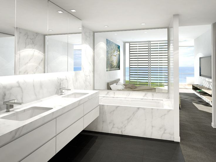 Ensuite with dark floors and white marble tiles.