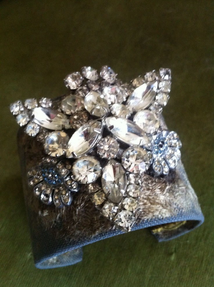 Vintage fabric cuff adorned with vintage rhinestone pieces. $95