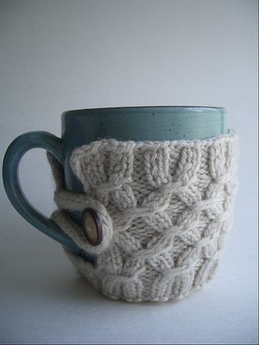 Knitted mug cozy. Could also use recycled sweaters.