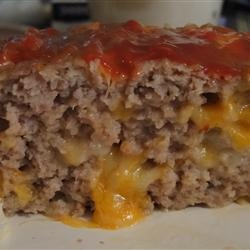 Cheesy Turkey Meatloaf. Colby cheese cubes on inside. So good. I cut ...