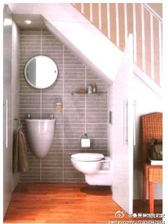 Under stairs half bath who knew now that 39 s clever for Bathroom designs under stairs