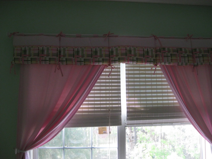 Repurposed baby bumper. Using the bumper from my crib bedding set, (since it wasn't breathable) I made it into a valance for the windows