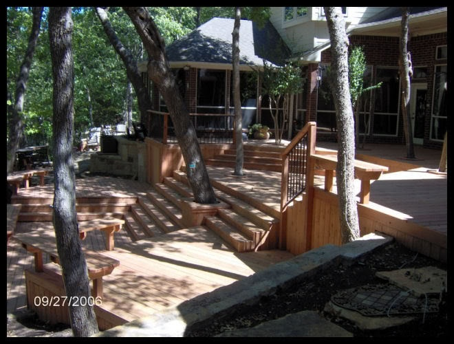 like the integration with the trees cool multilevel deck