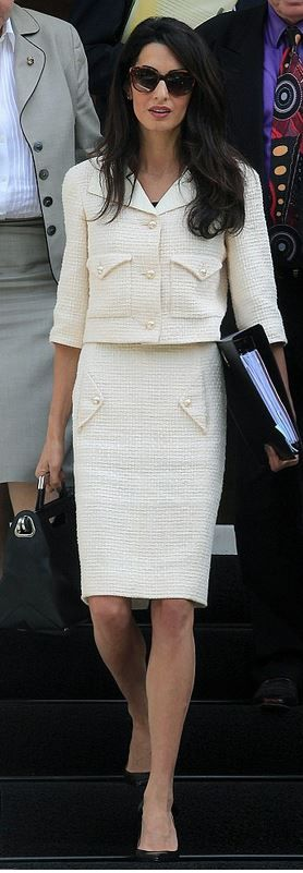 Who made Amal Clooney's brown sunglasses, white jacket, and skirt