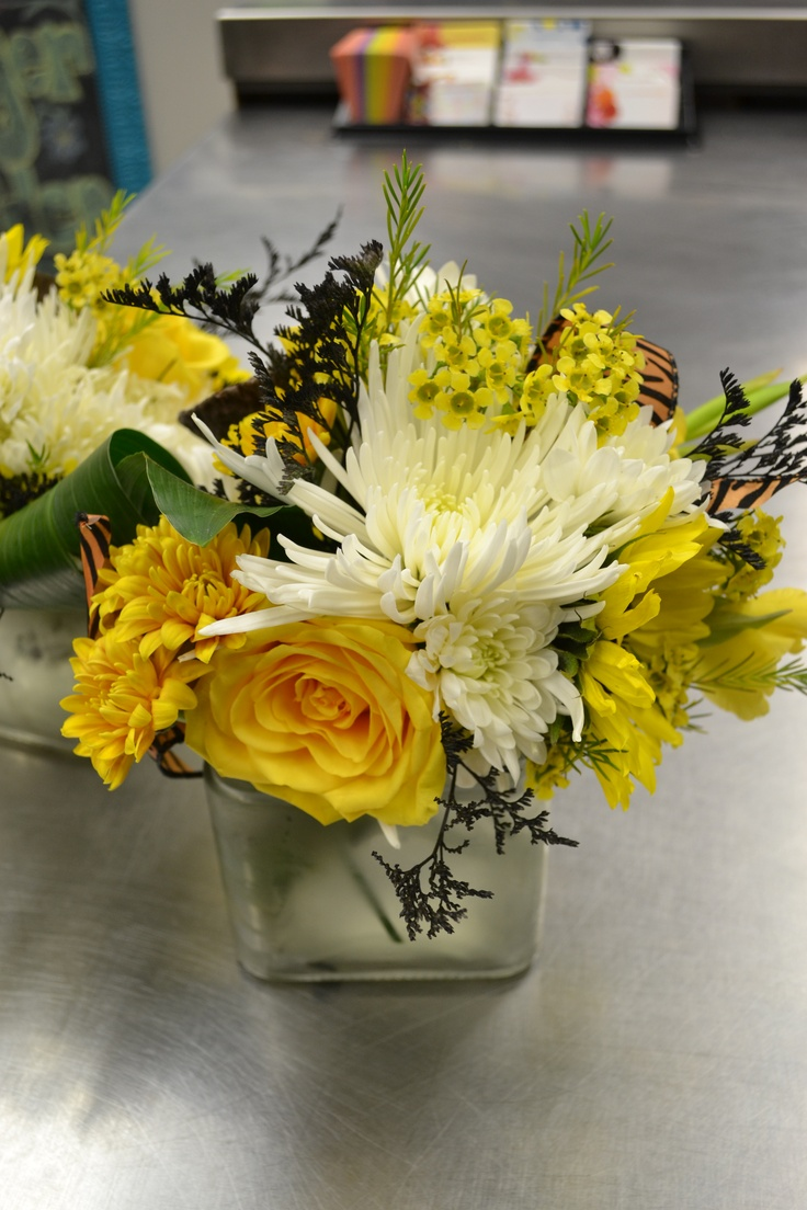 Mizzou centerpiece with spider mums daisy roses