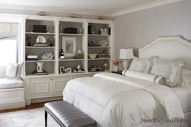 Love the grey on the backs of the shelves and the lighting above each.