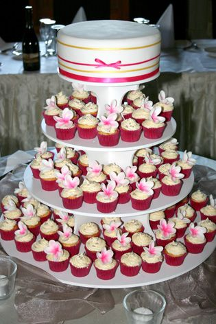 Super funky mini cupcake tower with frangipani's and a cutting cake - by Classic Cakes