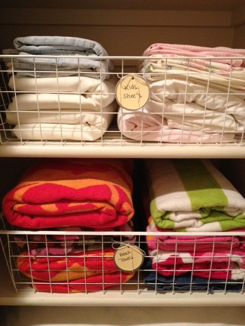 Minimize the jumbled sheets and migrating towel issues with these wire baskets from IKEA. Via morganize with me: Organized Linen Closet