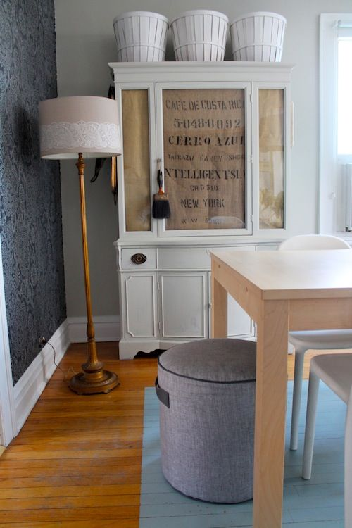 Love this house. Love the privacy/storage flexibility they created for this piece by lining the glass with  Kraft paper & an old coffee bean sack(?). So many possibilities!