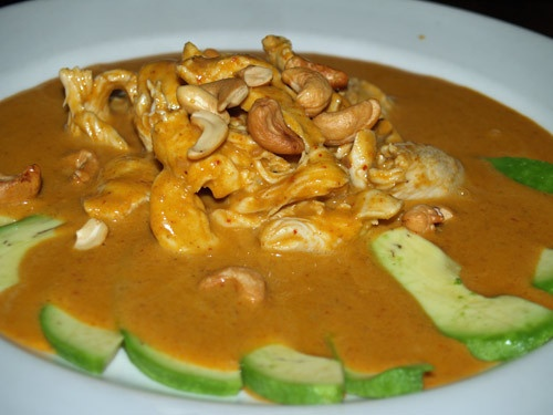 Chicken Massaman Curry with avocado and topped with cashew nuts