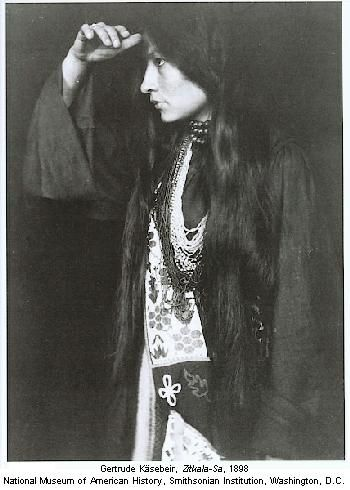 "Zitkala-Sa ""Red Bird"" a Lakota woman who was a member of Buffalo Bill's Wild West Show in NYC. Zitkala-Sa was becoming well-known as a performer, writer, musician, and more recently, as an advocate on behalf of Native Americans. She was included in Harper's Bazaar's 1900 list of ""Persons Who Interest Us."""
