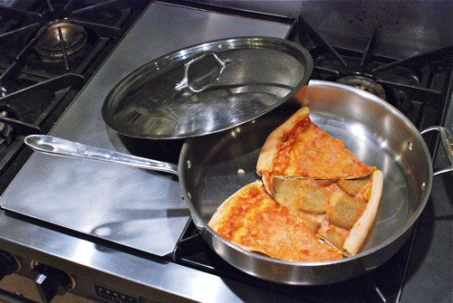 Reheat Pizza Heat up leftover pizza in a nonstick skillet on top of the stove, set heat to med-low and heat till warm. This keeps the crust crispy. No soggy micro pizza.     Previous pinner:  I saw this on the cooking channel and it really works.