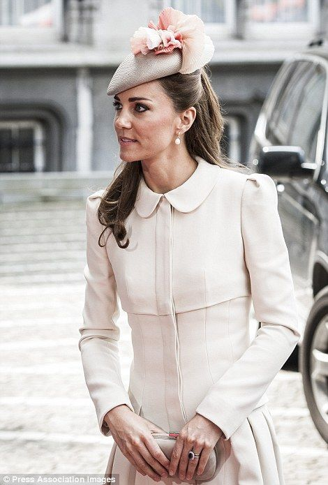 Kate wore a cream coat by Alexander McQueen and pearl drop earrings for today's commemorat...