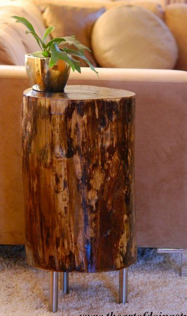 DIY side table.  I love the combo of natural wood with stainless/contemporary legs.