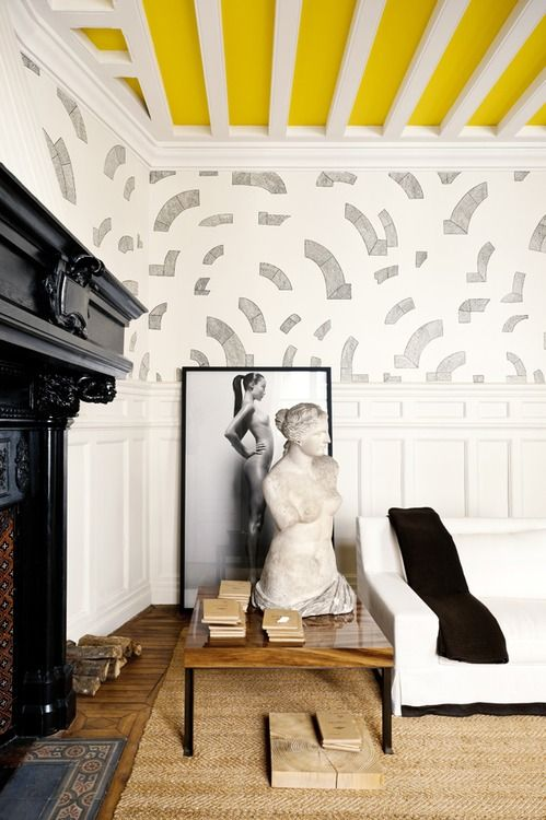 L' Autre Appartement Paris by Gilles & Boissier puts the color on the ceiling instead of the walls and creates height...