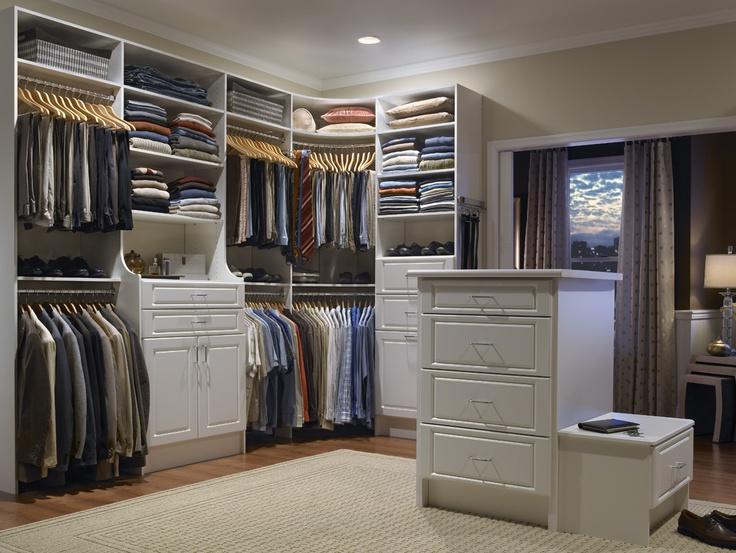 Walk in closet with rods in corner in the closet Master bedroom closet hardware
