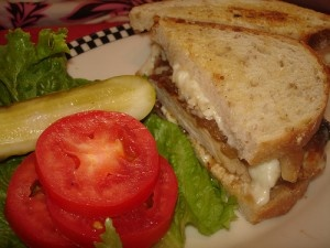 Charmoula Chicken: North African Spiced Chicken Breast, Jack Cheese, Caramelized Onion on Grilled Sourdough with a Lemon, Garlic Aioli