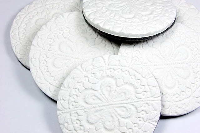 Coasters with doily pattern made from air dry clay and wool felt