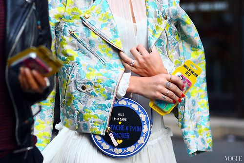 Kate Foley wearing a Opening Ceremony jacket paired with a Olympia Le-Tan bag during London Fashion Week (image: vogue)