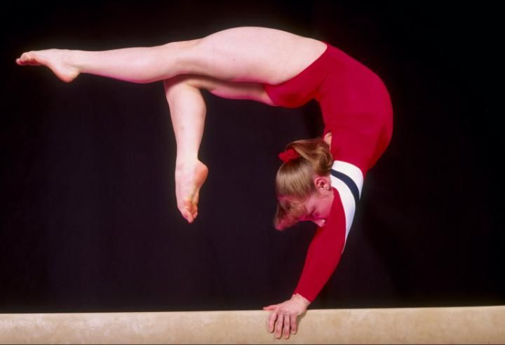 action on the balance beam. (Mandatory Credit: Tony Duffy /Allsport